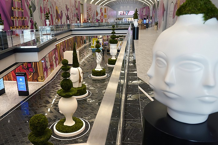 Sculptures by Jonathan Adler are displayed in The Avenue, a luxury shopping wing of the American Dream mall, before its grand opening in East Rutherford, N.J., Wednesday, Sept. 15, 2021.  If you build it during a pandemic, will they still come? American Dream put that to the test when it opened the new luxury shopping wing of its megamall in September.  The new wing comes as the world grapples with the highly contagious delta variant of the coronavirus, which continues to threaten life — and business — from returning to normal. (AP Photo/Seth Wenig)
