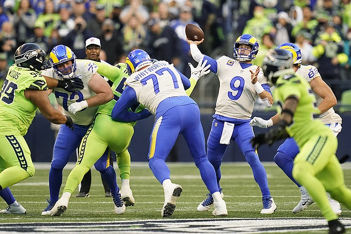 Los Angeles Rams quarterback Matthew Stafford (9) passes against the Seattle Seahawks during the first half of an NFL football game, Thursday, Oct. 7, 2021, in Seattle. (Elaine Thompson/AP)