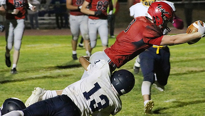 Troy Edwards of Lee Williams High School reaches for a touchdown against Kingman on Friday, Oct. 1. The Volunteers will attempt to improve to 4-2 on the season when they travel to Coconino High School on Saturday, Oct. 9. (Photo by Travis Rains/Kingman Miner)