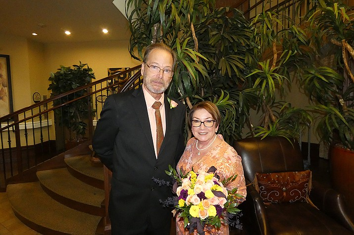"""On Saturday, Oct. 2, two Alta Vista employees were married at the senior living community located at 916 Canterbury Lane in Prescott.  Carolyn Kearley is a receptionist, and Jim Beery is a driver for Alta Vista. When they started working together, it seemed they had some communication issues, and did not really get along too well. But, their positions are so important, especially on appointment days at the community, that they had to work through some things, becoming patient and speaking with kinder tones to one another.  Fast forward to November 2020. Carolyn and Jim were able to work out their """"communication issues"""" and in fact, communication was now excellent! So excellent that they fell in love and planned to marry in 2021.  The staff of Alta Vista worked alongside both of the lovebirds to make sure this day was memorable. They of course wanted to get married at Alta Vista, where residents and staff could all be a part of their special day! Residents and staff always say they are a family, and looks like this gets more true every day! (Courtesy)"""