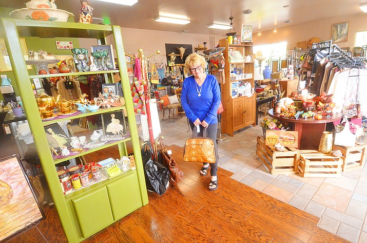 Patricia Garitson stands in her new store, Hidden Treasures, 675 E. Cottonwood St., an upscale resale store. She opened for business June 5, 2021. (Vyto Starinskas/Independent)