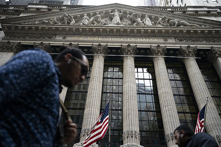 Wall Street capped a wobbly day of trading with a broad slide for stocks Friday, after a weak jobs report raised questions about the Federal Reserve's timeline to pare back its immense support for markets. (John Minchillo/AP)