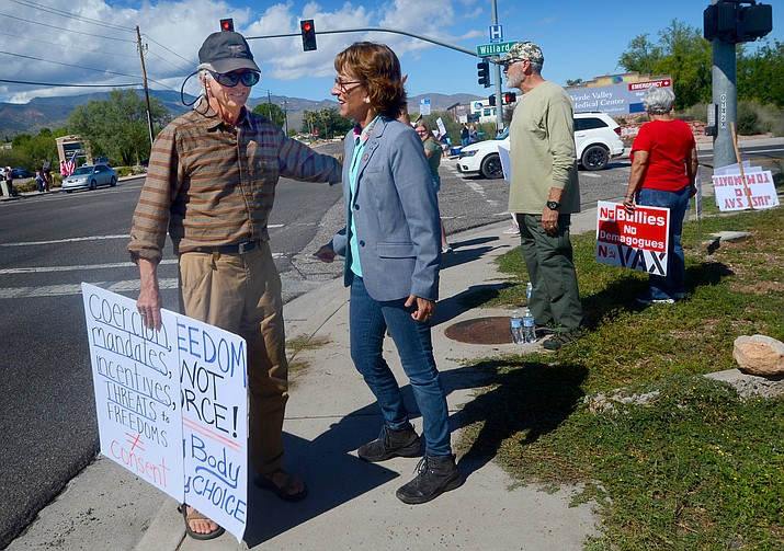 State Sen. Wendy Rogers speaks with Will Toms on the State Route 89A in Cottonwood on Thursday, Oct. 6, 2021. During a protest against the requirement for COVID vaccinations for employment at the Verde Valley Medical Center. (Vyto Starinskas/Independent)