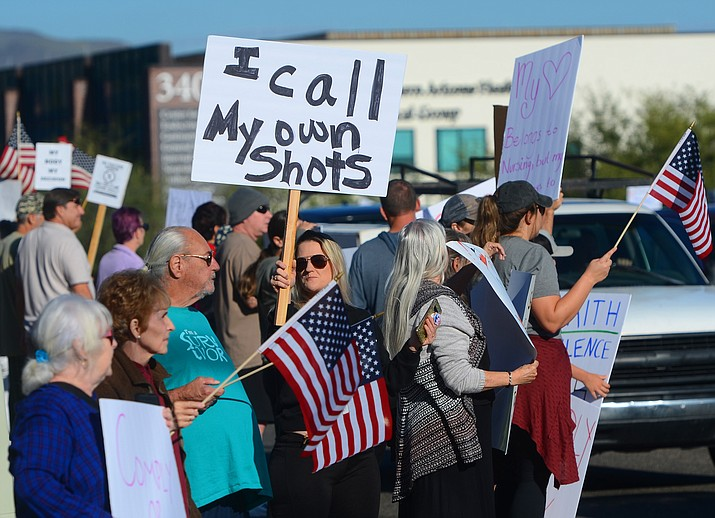 More than 225 demonstrators against a COVID-vaccination mandate, which is now required for employment at the Verde Valley Medical Center, turned out on State Route 89A in Cottonwood on Wednesday, Oct. 6, 2021. (Vyto Starinskas/Independent)