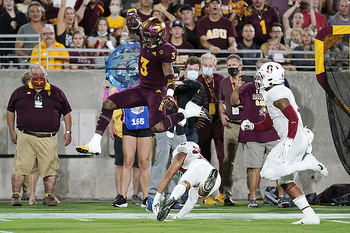 Arizona State running back Rachaad White (3) leaps over Stanford safety Alaka'i Gilman as Stanford linebacker Levani Damuni gives chase during the first half of an NCAA college football game Friday, Oct. 8, 2021, in Tempe, Ariz. ( Ross D. Franklin/AP)