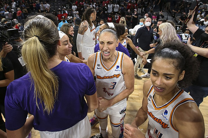 Phoenix Mercury guard Diana Taurasi (3) celebrates with teammates after the Mercury defeated the Las Vegas Aces 87-84 in Game 5 of a WNBA basketball playoff series Friday, Oct. 8, 2021, in Las Vegas. (AP Photo/Chase Stevens/AP)