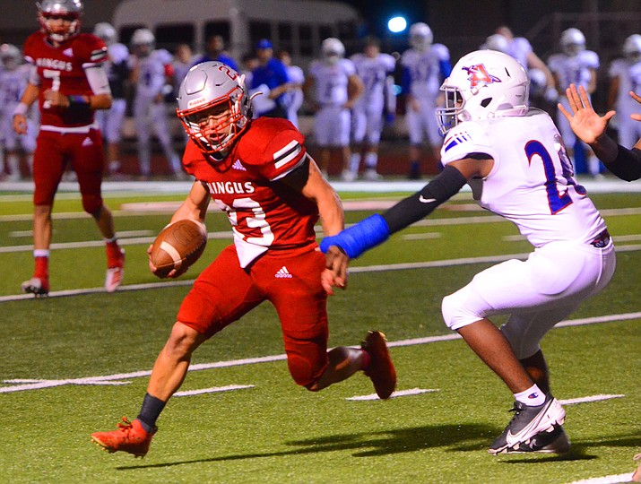 Mingus running back Angelo Alvarez (23) attempts to avoid an Arcadia defender Friday, Oct. 8, 2021, in Cottonwood. The Marauders lost 42-32. (Vyto Starinskas/Independent)