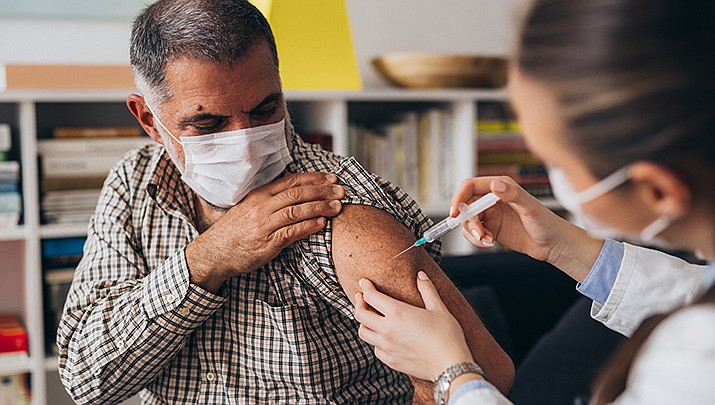 Public health officals are attributing the recent increase in vaccine administration in the U.S. to the availability of booster shots for the elderly and employer mandates. (Adobe image)