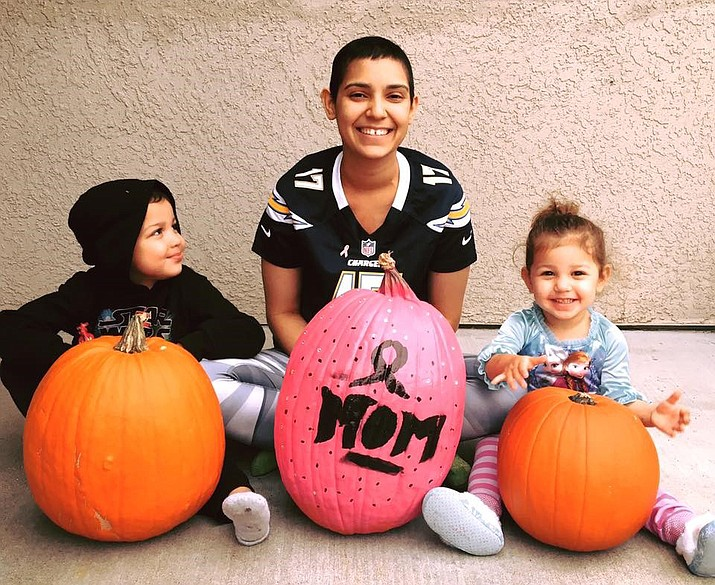 Denisha Ozuna, middle, sits with her two children, Chaz Jr., left, and Melannie, for Halloween. (Ozuna family/Courtesy)