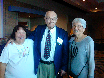 In this September 2017 file photo, Amy LaFleur, left, Dr. Henry Lynch, middle, and Marilyn Roberts pose for a photo at a symposium honoring Dr. Lynch for his decades of research in breast cancer. (Roberts family/Courtesy)