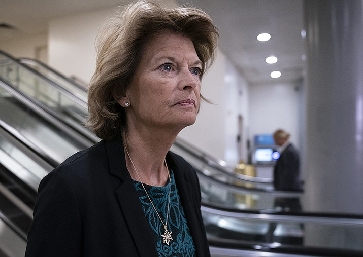 In this Jan. 8, 2020, file photo Sen. Lisa Murkowski, R-Alaska, heads to a briefing on Capitol Hill in Washington. An Alaska man faces federal charges after authorities allege he threatened to hire an assassin to kill Murkowski, according to court documents unsealed Wed., Oct. 6, 2021. (AP Photo/J. Scott Applewhite,File)