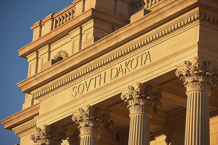 """In this Jan. 12, 2021 file photo, sun shines on state Capitol in Pierre, S.D. The """"Pandora Papers"""" investigation revealed how the rich and powerful have been shielding their wealth in offshore accounts, including in trust-friendly states like South Dakota. As these so-called """"dynasty trusts"""" are increasingly becoming known as tax havens for wealthy Americans and foreigners, some experts worry it could spell bad news for charities. (Erin Bormett//The Argus Leader via AP)"""