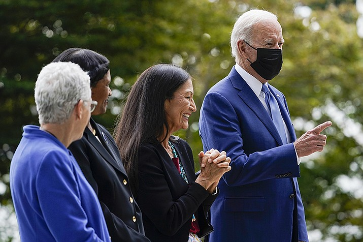 President Joe Biden gestures on the North Lawn of the White House in Washington, Oct. 8, with White House national climate adviser Gina McCarthy, Brenda Mallory, chair of the council on environmental quality, and Interior Secretary Deb Haaland during an event announcing that his administration is restoring protections for two sprawling national monuments in Utah that have been at the center of a long-running public lands dispute, and a separate marine conservation area in New England that recently has been used for commercial fishing. (AP Photo/Susan Walsh)