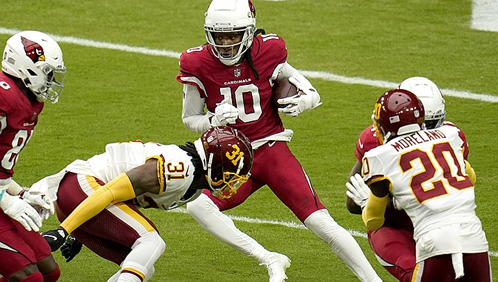 Wide receiver DeAndre Hopkins made a key catch as the Arizona Cardinals remained undefeated at 5-0 with a 17-10 home win over the San Francisco 49ers in an NFL game played on Sunday, Oct. 10. (AP file photo)