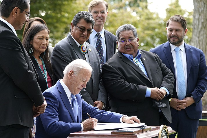 President Joe Biden signs proclamations on the North Lawn at the White House in Washington, Oct. 8, during an event announcing that his administration is restoring protections for two sprawling national monuments in Utah that have been at the center of a long-running public lands dispute, and a separate marine conservation area in New England that recently has been used for commercial fishing. (AP photo/Susan Walsh)