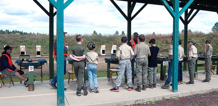 The Scouts on the .22 rimfire rifle range listen as Williams Sportsman's Club President Keith Heimes (right) presents safety and shooting fundamentals while fellow RSO's Wynn Simon (left) and Chuck Corcoran watch. (Photo by Williams Sportsman's Club, Chris Mayer)