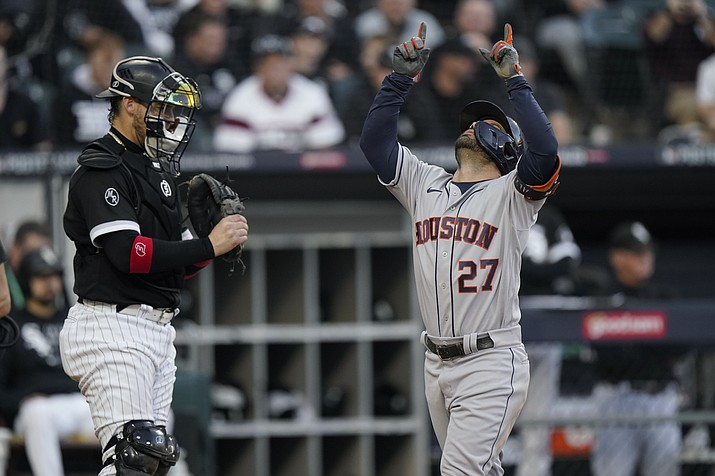Houston Astros' Jose Altuve (27) celebrates his home run during Game 4 of an American League Division Series Tuesday, Oct. 12, 2021, in Chicago. (Nam Y. Huh/AP)
