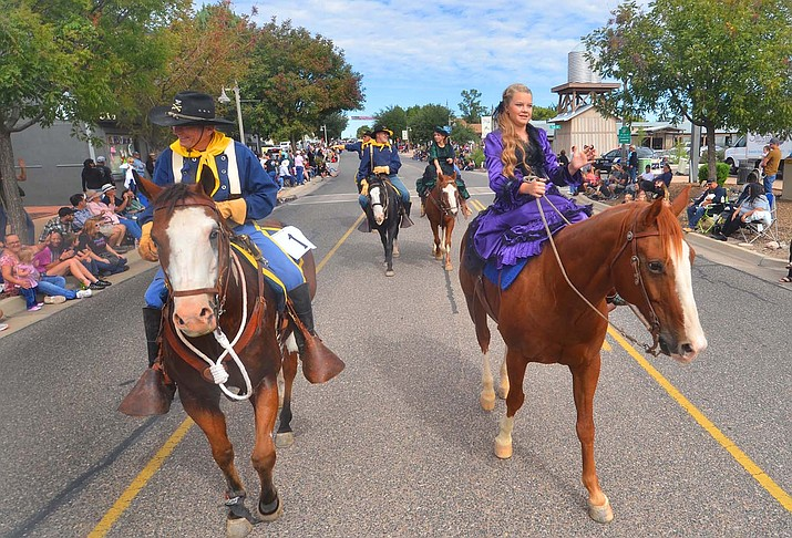 Marchers head down Main Street during the Camp Verde parade on Saturday, Oct. 9, 2021. Later, reenactors mingled with the visitors at the Fort Verde State Park. This year's Colonel's Daughter Aislynn Mulcaire waved to the crowd. (Vyto Starinskas/Independent)