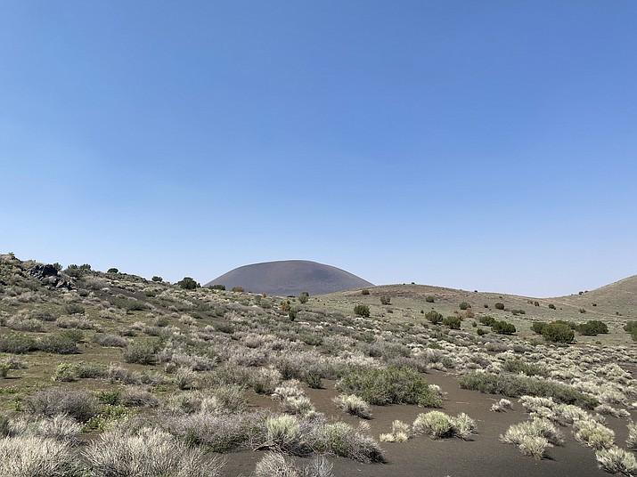 An area of barren land on the Navajo Reservation in Leupp, Arizona, overlooking a mountain. (Photo/Katrina Machetta)