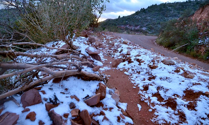 A dusting of snow fell on Perkinsville Road above Jerome and higher elevations of Mingus Mountain on Tuesday morning, Oct. 12, 2021. Even colder temperatures were expected early Wednesday morning. (Vyto Starinskas/Independent)