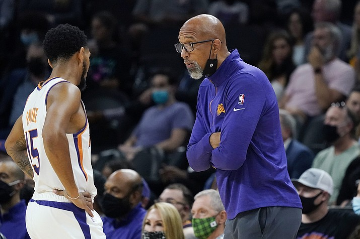 Phoenix Suns coach Monty Williams, right, talks with guard Cameron Payne during the first half of the team's preseason game against the Los Angeles Lakers on Wednesday, Oct. 6, 2021, in Phoenix. The Suns won 117-105. (Ross D. Franklin/AP)