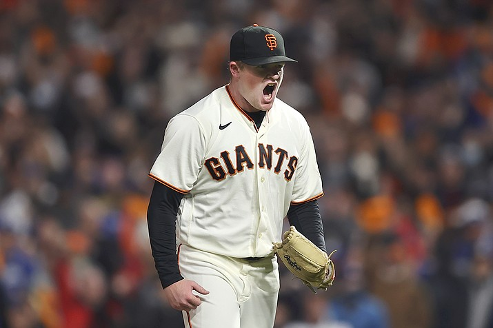 San Francisco Giants pitcher Logan Webb reacts after striking out Los Angeles Dodgers' Trea Turner during the sixth inning of Game 1 of a baseball National League Division Series Friday, Oct. 8, 2021, in San Francisco. (John Hefti/AP)