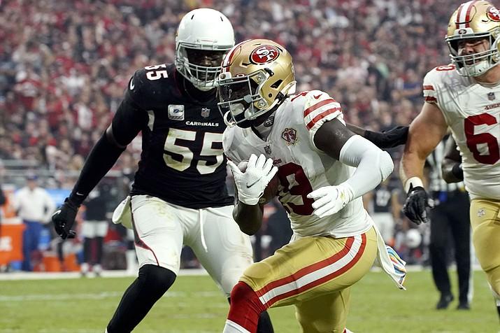 San Francisco 49ers wide receiver Deebo Samuel (19) scores a touchdown as Arizona Cardinals linebacker Chandler Jones (55) defends during the second half of an NFL football game, Sunday, Oct. 10, 2021, in Glendale, Ariz. (Darryl Webb/AP)