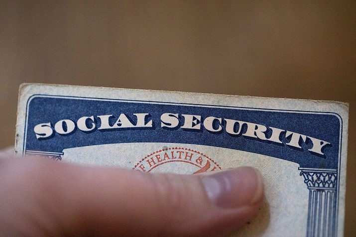 This Tuesday, Oct. 12, 2021 photo shows a Social Security card. Millions of retirees on Social Security will get a 5.9% boost in benefits for 2022. The biggest cost-of-living adjustment in 39 years follows a burst in inflation as the economy struggles to shake off the drag of the coronavirus pandemic. (Jenny Kane/AP)