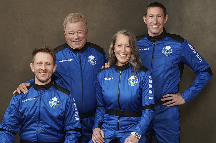 This undated photo made available by Blue Origin in October 2021 shows, from left, Chris Boshuizen, William Shatner, Audrey Powers and Glen de Vries. Their launch scheduled for Wednesday, Oct. 13, 2021 will be Blue Origin's second passenger flight, using the same capsule and rocket that Jeff Bezos used for his own trip three months earlier. (Blue Origin via AP)