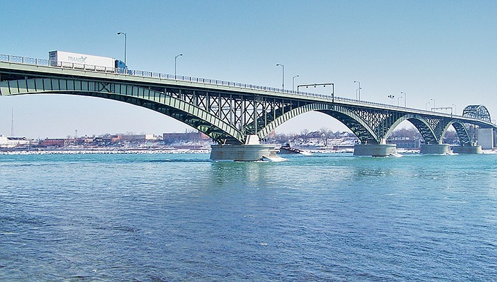 The U.S, borders with Canada and Mexico will reopen for nonessential travel in November, but all visitors to the U.S. must show proof of being vaccinated against the coronavirus. The Peace Bridge, which connects the U.S. with Canada at Buffalo, New York, is pictured. (Photo by Ooinn, cc-by-sa-3.0, https://bit.ly/3iwOlXM)