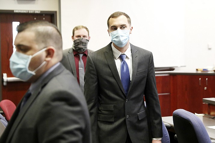 U.S. Air Force airman Mark Gooch, right, looks towards the empty jury box as he is led out of Coconino County Superior Court in Flagstaff, Arizona, Oct. 13 after being found guilty of first degree murder and kidnapping in the January 2020 death of Sasha Krause. The two didn't know each other and lived hundreds of miles apart but shared an upbringing in the Mennonite religion. Krause committed to the church, but Gooch did not. Gooch, 22, faces up to life in prison. (Jake Bacon/Arizona Daily Sun via AP)
